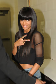 Ciara wore modern gold rings with pretty pink nail polish.