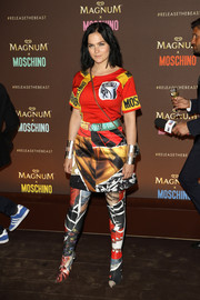 Leigh Lezark tied her busy-looking ensemble together with a pair of printed over-the-knee boots by Moschino.