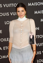 Margherita Missoni layered a nude cardigan over a white turtleneck for the Maison Louis Vuitton Roma Etoile opening party.