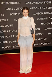 Margherita Missoni attended the Maison Louis Vuitton Roma Etoile opening party wearing a pair of ombre wide-leg pants.