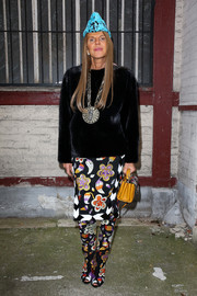 Anna dello Russo styled her plain black top with a chic floral pencil skirt and matching peep-toe boots, both by Tom Ford.