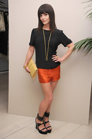 Christina Ricci attended the launch of Maiyet in NYC wearing patten leather platform sandals with laced ankle cuffs.