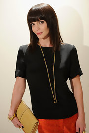 Christina Ricci wore her shiny dark hair pin-straight with blunt brow-length bangs at the launch of Maiyet in NYC.