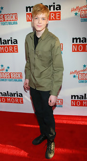 Cameron Monaghan wore black leather lace-up shoes to Malaria No More's 'Hollywood Bites Back!' event.