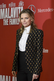 Michelle Pfeiffer opted for a menswear-inspired look with a gold-embroidered Alexander McQueen jacket and a pair of high-waist pants when she attended the premiere of 'The Family.'