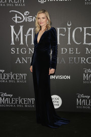 Michelle Pfeiffer looked regal in a midnight-blue velvet gown by Monique Lhuillier at the European premiere of 'Maleficent: Mistress of Evil.'
