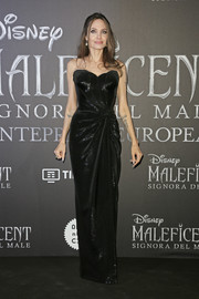Angelina Jolie looked downright elegant in a strapless black gown by Atelier Versace at the European premiere of 'Maleficent: Mistress of Evil.'