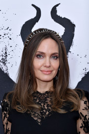 Angelina Jolie framed her beautiful face with a loose, center-parted hairstyle for the 'Maleficent: Mistress of Evil' photocall in London.