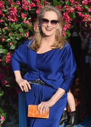 Meryl Streep worked a striking color pairing with this orange box clutch and blue dress combo at the world premiere of 'Mamma Mia! Here We Go Again.'