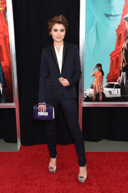 Sami Gayle went for modern styling with a purple and white snakeskin purse.