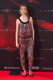Arantxa showed off her long and lean figure with this tribal-print jumpsuit.