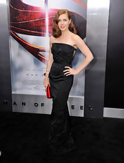 Amy Adama chose an elegant black strapless dress with rosebud embellishments on the bust for her look at the 'Man of Steel' premiere in NYC.