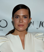 Mandy Moore wore her hair in a slick ponytail with a deep side part at the Dujour Magazine cover party.