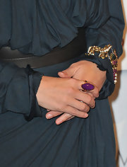 Julia paired her navy blue draped dress with a bold purple cocktail ring.