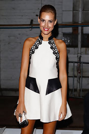 Laura Dundovic looked modern and chic in an embroidered black-and-white halter dress at the Manning Cartell fashion show.