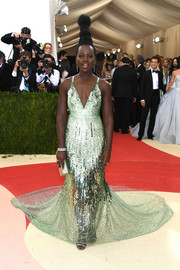 Lupita Nyong'o radiated in a green sequin gown by Calvin Klein at the Met Gala.