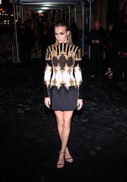 Josephine Skriver attended a Met Gala after-party wearing an ornately embellished mini dress by Balmain.