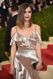 Rose Byrne was all aglow at the Met Gala with this Jimmy Choo mirrored clutch and gold Ralph Lauren gown combo.