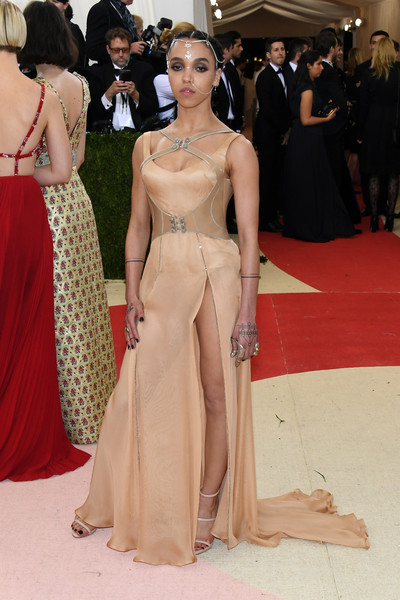 FKA Twigs donned a nude Atelier Versace gown with a matching leather harness for her Met Gala look.