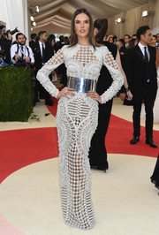 Alessandra Ambrosio was statuesque and sophisticated at the Met Gala in a form-fitting silver Balmain gown featuring the brand's signature rope detailing.