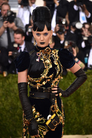 Katy Perry teamed fingerless leather gloves with a heavily embellished dress for total edge at the Met Gala.