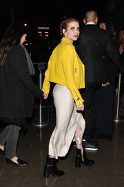 Emma Roberts headed to a Met Gala after-party wearing a bright yellow leather jacket by Victoria Beckham.