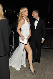 Kate Hudson headed to a Met Gala after-party teetering on a pair of silver Giuseppe Zanotti peep-toe pumps.