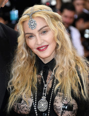 Madonna styled her hair into a half-up wavy 'do for the Met Gala.