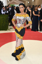Demi Lovato attended the Met Gala sporting an eclectic mix of patterns and textures in this Moschino paillette-panel gown that clung to every curve.