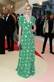 Elizabeth Debicki was demure in a green floral gown by Prada at the Met Gala.
