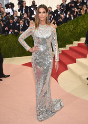 Cindy Crawford went for futuristic glamour in a mirrored column dress by Balmain at the Met Gala.