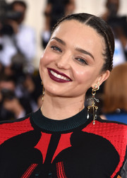 Miranda Kerr sported a hippie-glam center-parted, braided updo at the Met Gala.