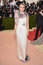 Saoirse Ronan got all frilled up in a feather-embellished column dress by Christopher Kane for the Met Gala.