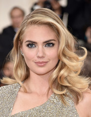 Kate Upton was gorgeously coiffed with this high-volume curly 'do at the Met Gala.