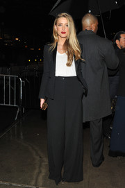 Amber Heard attended a Met Gala after-party wearing a simple black wide-leg pantsuit.