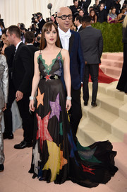 Dakota Johnson looked adorably chic at the Met Gala in a Gucci lace-panel slip dress adorned with multicolored stars.