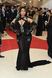 Nicki Minaj was almost bursting out of her strappy, sheer Moschino by Jeremy Scott gown during the Met Gala!