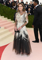 Queen Rania chose a feather-embellished monochrome gown for her Met Gala look.