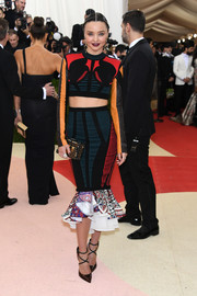 Miranda Kerr went the sporty-sexy route in a multicolored crop-top by Louis Vuitton during the Met Gala.