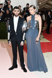 Gigi Hadid came dressed as a very fashionable robot in a mirror-accented halter gown by Tommy Hilfiger during the Met Gala.