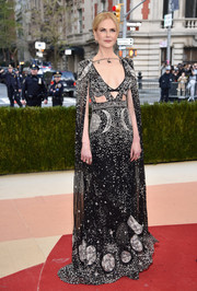 Nicole Kidman was all about cosmic glamour in a moon-and-star-embellished cutout gown by Alexander McQueen at the Met Gala.