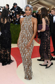 Ciara oozed major sex appeal at the Met Gala in this H&M halter gown featuring silver beading on a nude background.