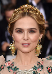Zoey Deutch looked romantic at the Met Gala with her loose center-parted chignon.