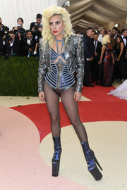 Lady Gaga commanded stares with her Atelier Versace ensemble, consisting of a bold-shouldered silver jacket, a strappy bra, and a corset belt, during the Met Gala.