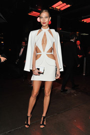 For her arm candy, Karlie Kloss chose a black-and-white clutch by Jimmy Choo.