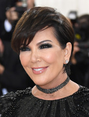 Kris Jenner wore her hair with a deep side part and and textured bangs at the 2016 Met Gala.