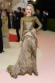 Rachel McAdams looked subtly sexy at the Met Gala in a Valentino gown featuring gold beading on a sheer nude background.