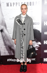 Chloe Sevigny went old school in a black-and-white checkered coat by Miu Miu for the New York premiere of 'Mapplethorpe: Look at the Pictures.'