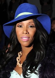 June Ambrose pulled off a fashion forward ensemble at the 2012 MBFW presentation of Mara Hoffman featuring a blue suede hat.