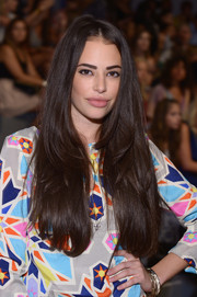 Chloe Bridges wore her lush locks loose with a center part when she attended the Mara Hoffman fashion show.